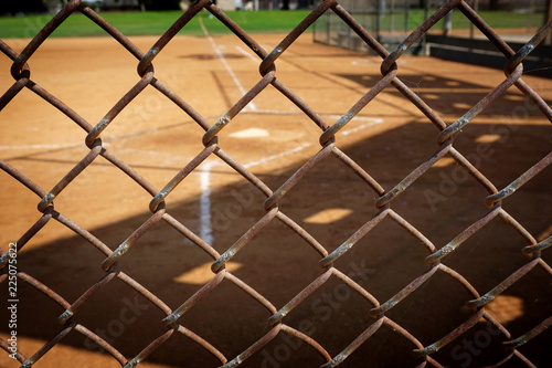 empty baseball field behind fence
