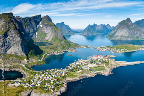 Papiers peints Vue aerienne Reine Lofoten Norway, aerial view of Norwegian traditional fishing village above polar circle with blue sea and mountains during sunny arctic summer, famous for Reinebringen hike