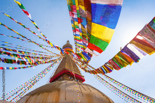 Fotografia Boudhanath stupa with colorful prayer flags, Buddha eyes and golden mandala in K