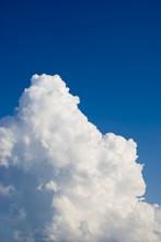 Edge Of A Huge Cloud Against The Blue Sky