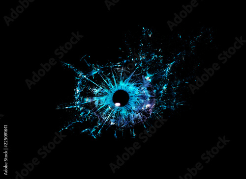 Stampa su Tela Conceptual creative photo of a blue human eye close-up macro that breaks into small pieces of glass isolated on a black background