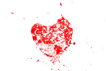 Creative Photo Of A Red Human Heart Symbol, Broken Into Small Pieces Of Glass Isolated On A White Background. Allegory Of Unhappy Love Is A Broken Heart.