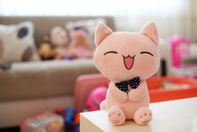 Plush Baby Soft Toy Cat Pink On The Table To Play