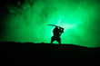 Leinwanddruck Bild - Fighter with a sword silhouette a sky ninja. Samurai on top of mountain with dark toned foggy background.