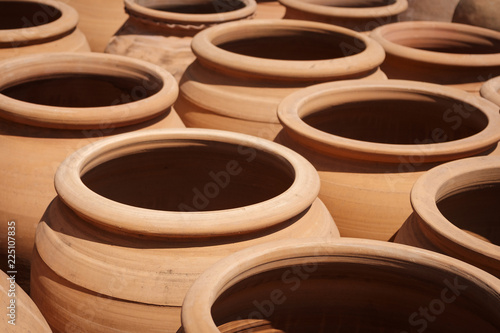 many clay pots, empty clay pot collection