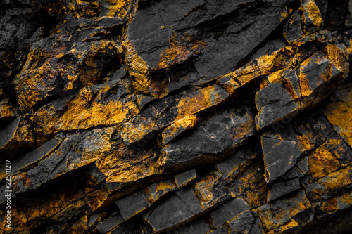 Fototapeta black rock background with gold  / yellow colored rocks obraz