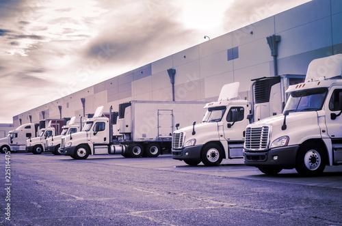 Stampa su Tela Trucks loading unloading at warehouse  shipping logistics transport concept imag