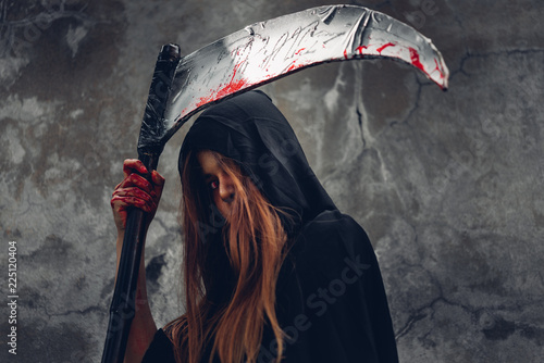 Photo  Woman ghost horror her have scythe on hand in forest,
