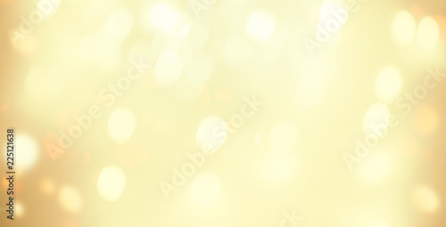 Golden Christmas  bokeh background with snowflake and gold  glittering bokeh stars. A shiny holiday card. Abstract  Glowing blurred lights