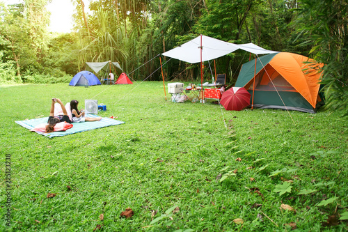 nature landscape camping tent with tarp and child family under tree on green gra Fotobehang