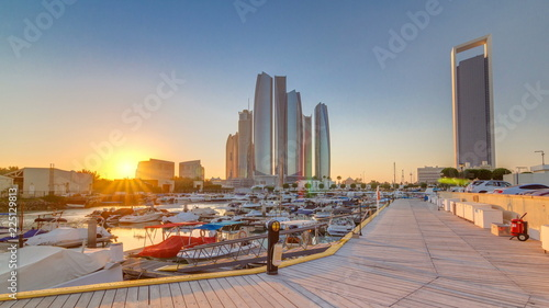 Poster Abou Dabi Al Bateen marina Abu Dhabi timelapse with modern skyscrapers on background