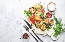 Grilled Colorful Vegetables, Aubergines, Zucchini, Pepper With Spice And Green Basil On Serving Board On White Background, Top View
