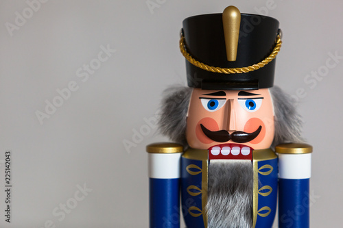 Cuadros en Lienzo Close-up of a handmade wooden Nutcracker Figurine - Soldier in blue Uniform, a t