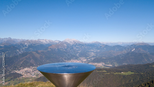 Fotobehang Blauwe jeans 4K Drone aerial view to the Seriana valley and Orobie Alps in a clear and blue day. Landscape from Pizzo Formico Mountain, Bergamo, Italy