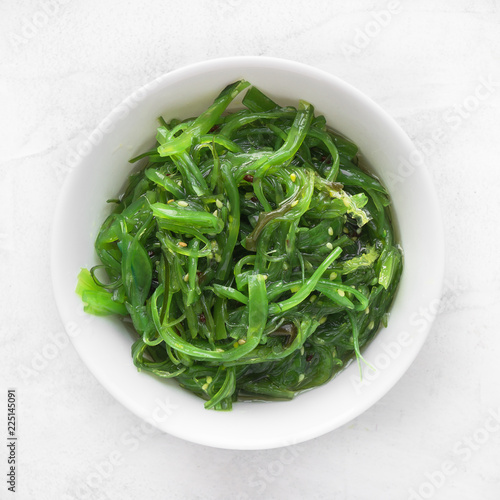 Wakame seaweed salad with sesame seed. Traditional Japanese food. Top view.