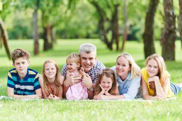 Obraz na Plexi Family with many children outdoors