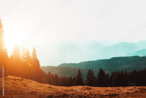 Foto op Plexiglas Wit Sun rising over a misty mountain landscape