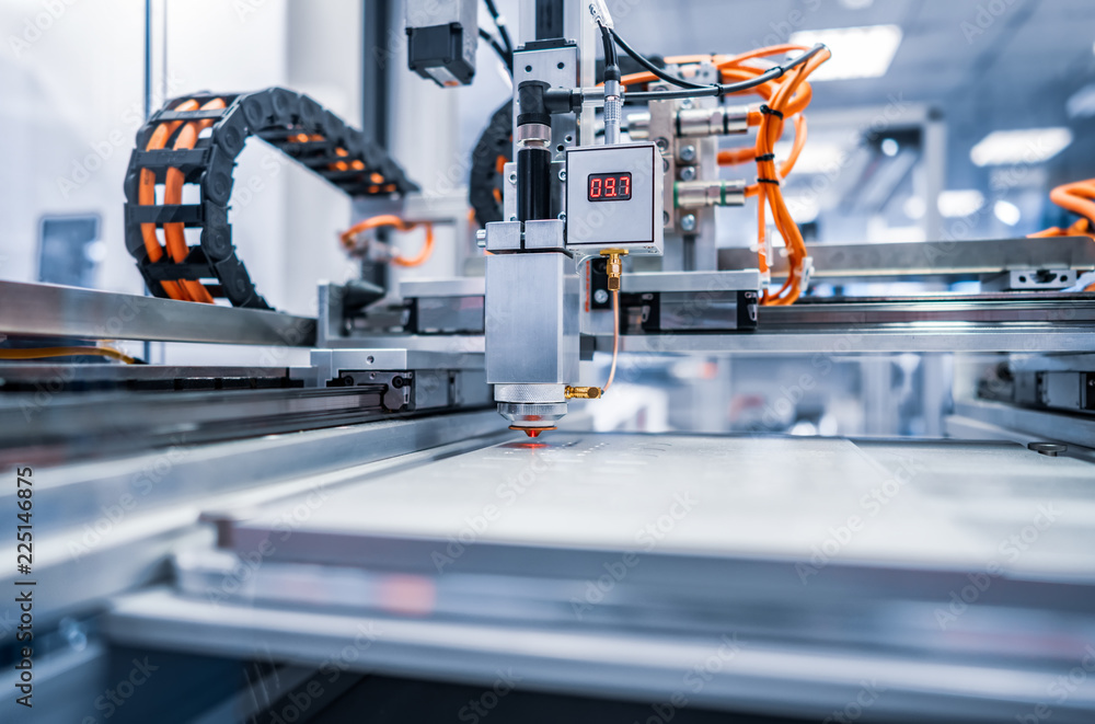 Fototapeta CNC Laser cutting of metal, modern industrial technology.