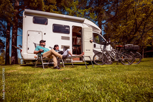 Poster de jardin Camping Woman with a man resting near motorhomes in nature. Family vacation travel, holiday trip in motorhome RV, Caravan car Vacation.