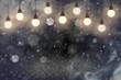cute bright glitter lights defocused bokeh abstract background with light bulbs and falling snow flakes fly, festal mockup texture with blank space for your content
