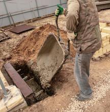 Concrete In A Wheelbarrow At A Construction Site