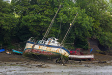 Abandoned Boat On Mooring In Mud