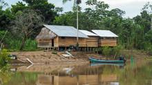 Remote Village In The Amazon Rainforest Of Peru