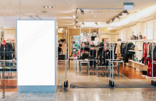 Photographie Clothes shop entrance with empty billboard mockup to place text, logo or adverti