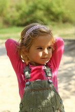 Cute Sunlit Toddler Girl In Pi...