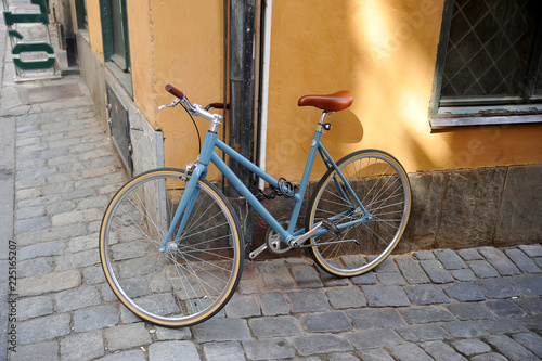 an old Bicycle tied to a drainpipe in Stockholm