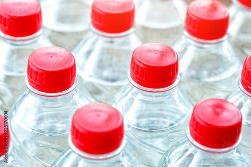 Fotografie, Obraz  plastic water bottles with red caps