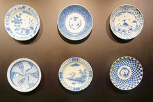 Plates On The Dark Wall