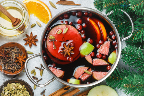 Mulled wine is a traditional winter drink with red wine, honey, orange, green Apple, cranberry and spices - cinnamon, cardamom, star anise, cloves, ginger, pepper. grog. punch. Christmas. New year