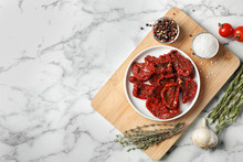 Flat Lay Composition With Dried Tomatoes And Space For Text On Marble Table