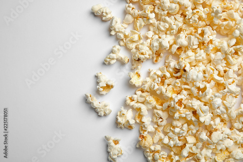 Delicious fresh popcorn on white background, top view