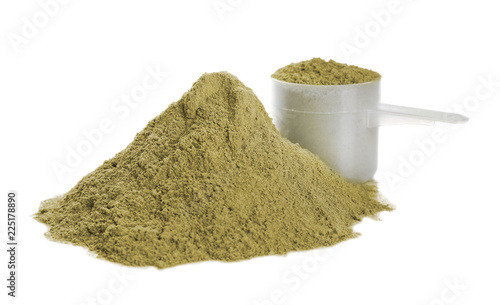 Hemp protein powder and measuring scoop on white background