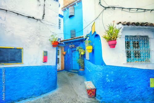Staande foto Afrika Blue color walls of houses with colorful flowerpots in Chefchaouen. Morocco, North Africa