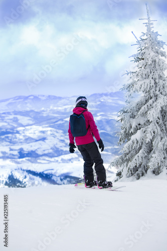 Man on snowboard in mountains
