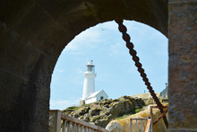 South Stack Lighthouse On Anglesey Framed By Arch