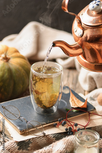 Fresh hot herbs tea with steam. Close up. Fall mood