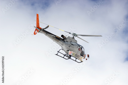 Tuinposter Helicopter Volunteer Mountain Rescue Service in action