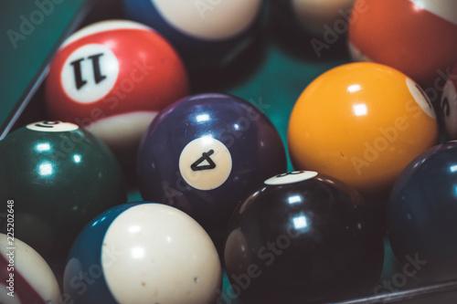 Photo playing biliard in a pool