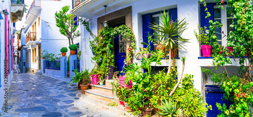 Traditional narrow streets with floral decoration in Greece. Skopelos island