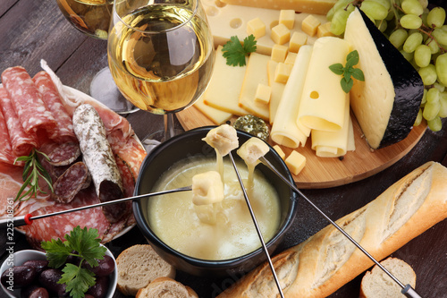 Gourmet Swiss fondue dinner on a winter evening with assorted cheese Canvas-taulu