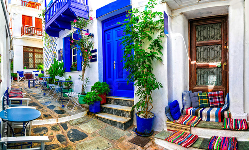 Traditional narrow streets with cute cafe bars in Greece. Skopelos island