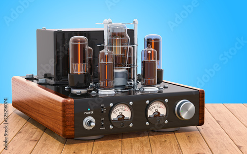 Photo Vintage vacuum tube amplifier on the wooden table. 3D rendering