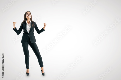 Young european businesswoman celebrating success