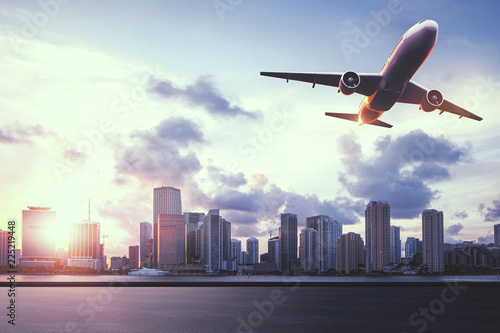 Fototapety, obrazy: City view with flying airplane