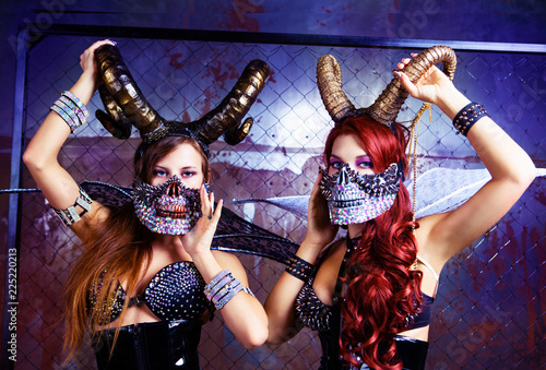 Fotografie, Tablou models wearing Halloween costume of leather and horns