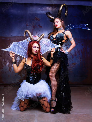 models wearing Halloween costume of leather and horns Fototapet